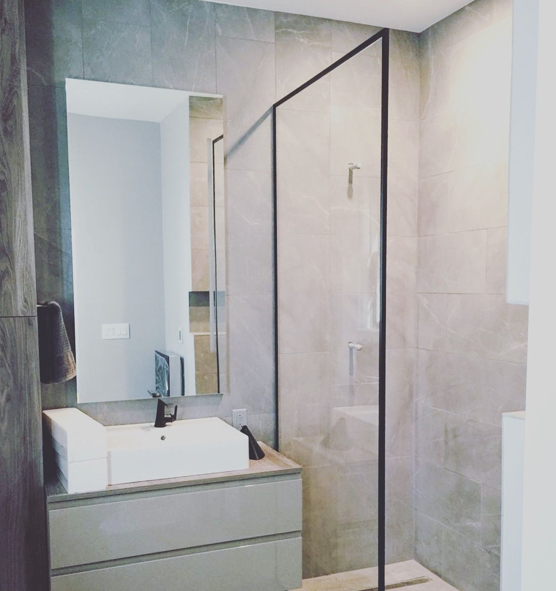 Beautiful shower glass splash panel with custom black framing by ...