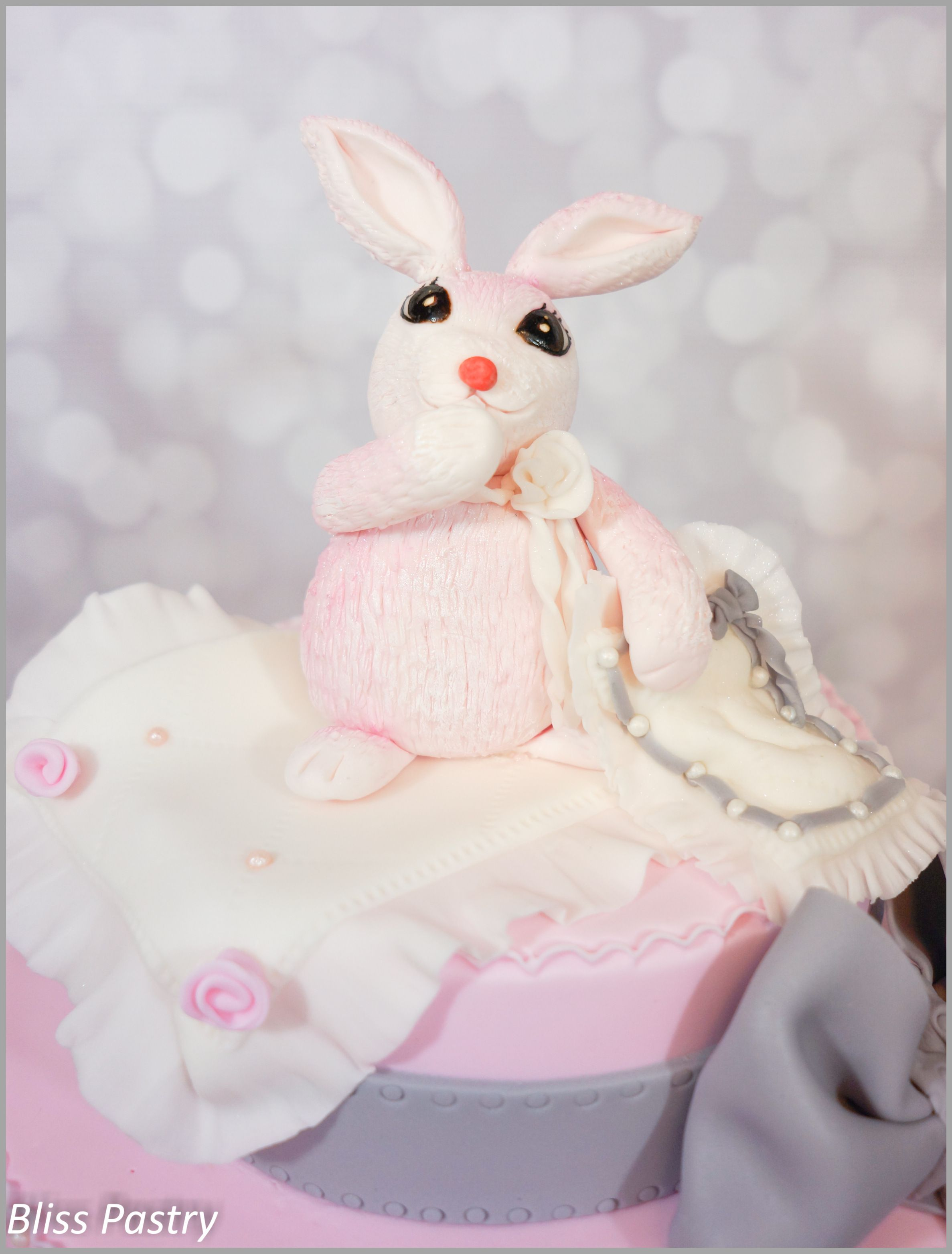 Baby bunny baby shower cake in pink and grey
