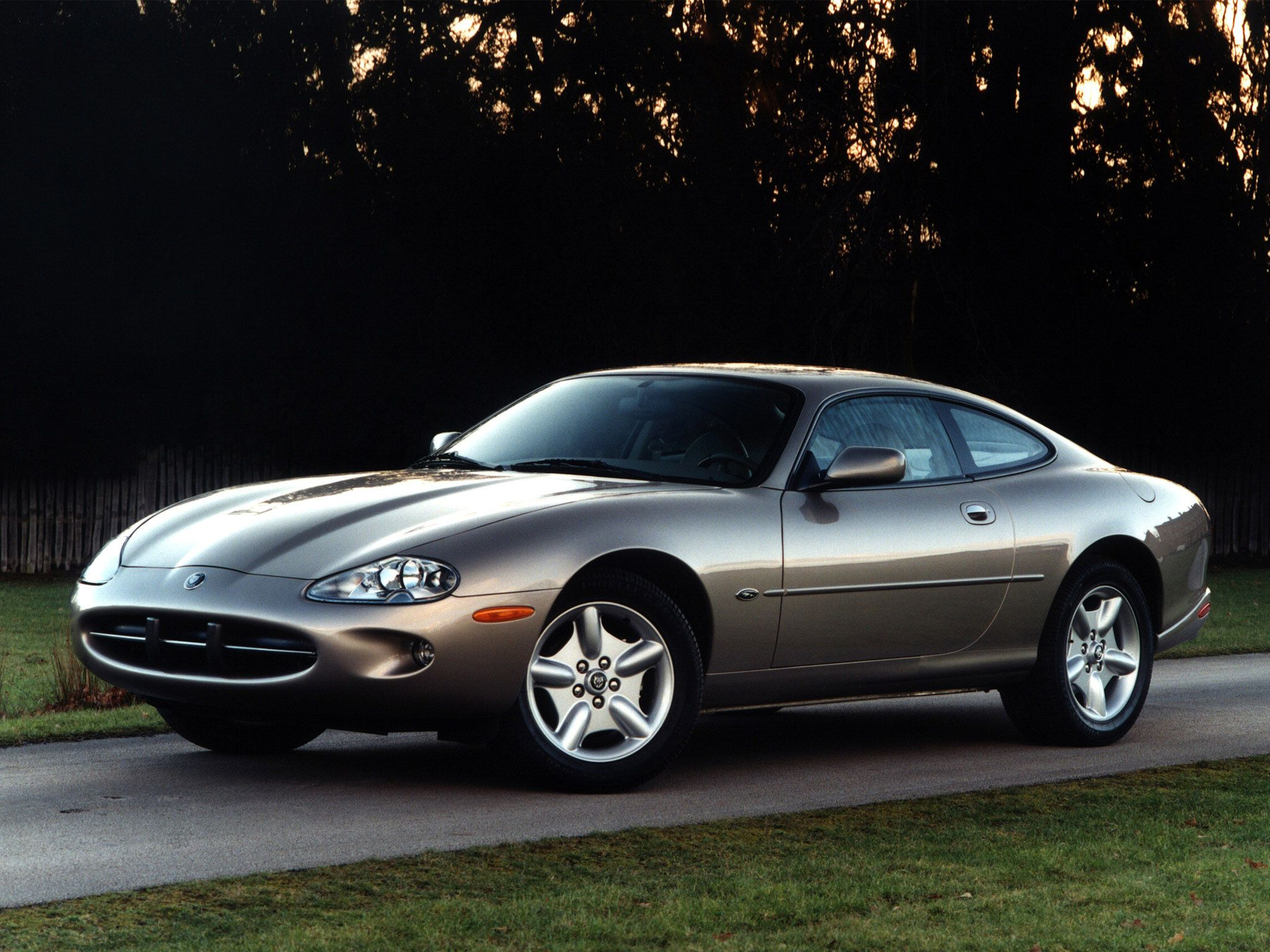 jaguar xk8 - unkind to describe it as a poor man's aston martin as
