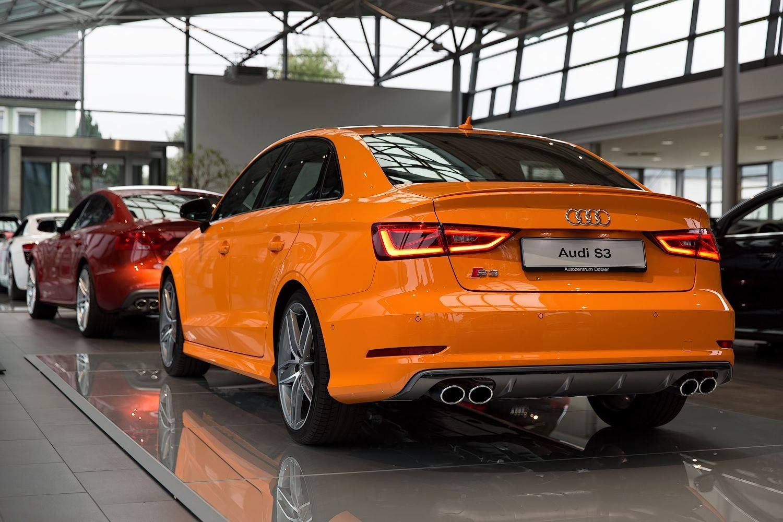 Audi s3 sedan with glut orange paint