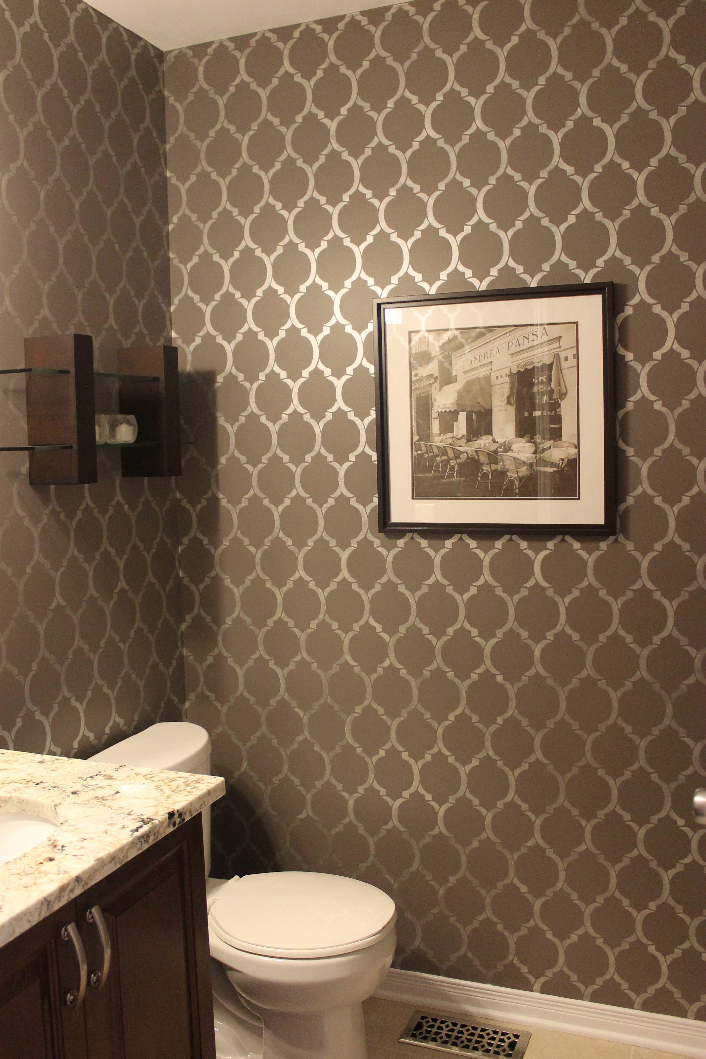 Gray powder room features walls clad in gray stripe