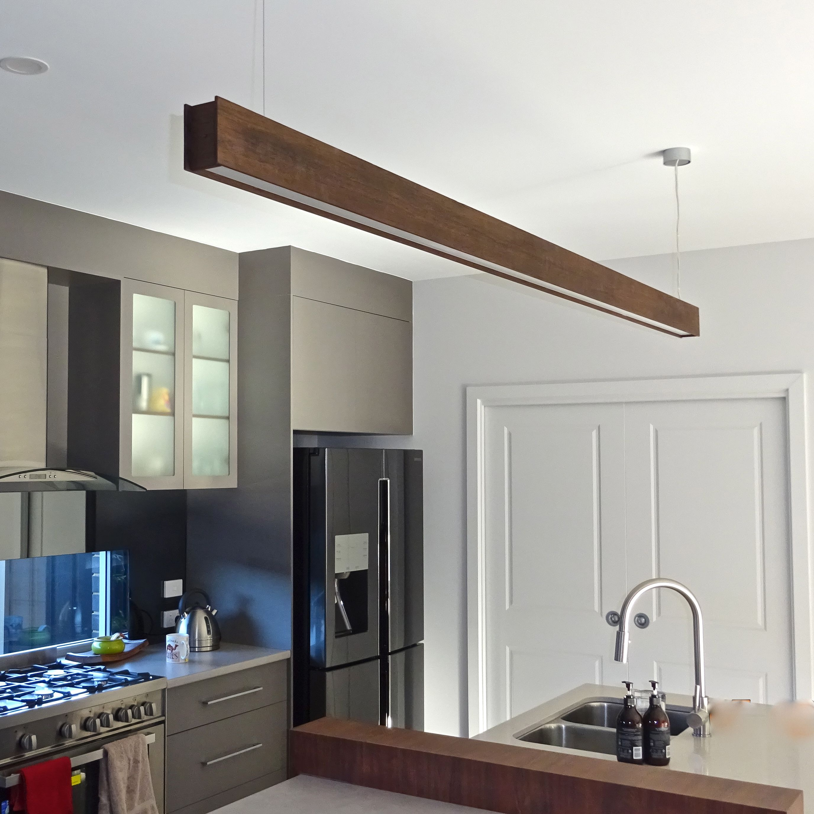Image result for timber hanging strip lighting over kitchen bench