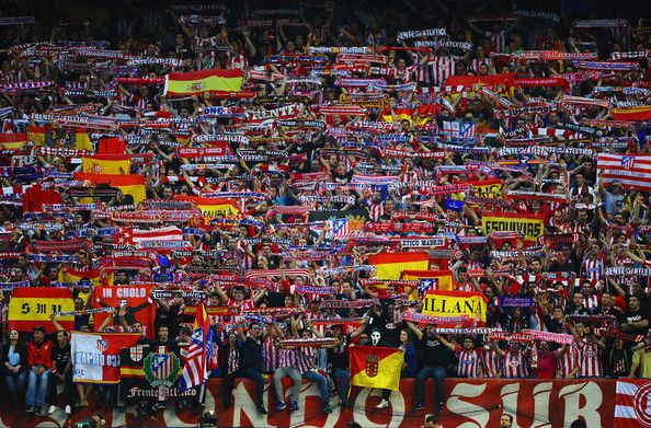 Atletico Madrid fans show their colours during the UEFA Champions League Quarter Final second leg match between Club Atletico de Madrid and FC Barcelona at Vicente Calderon Stadium on April 9, 2014 in Madrid, Spain.