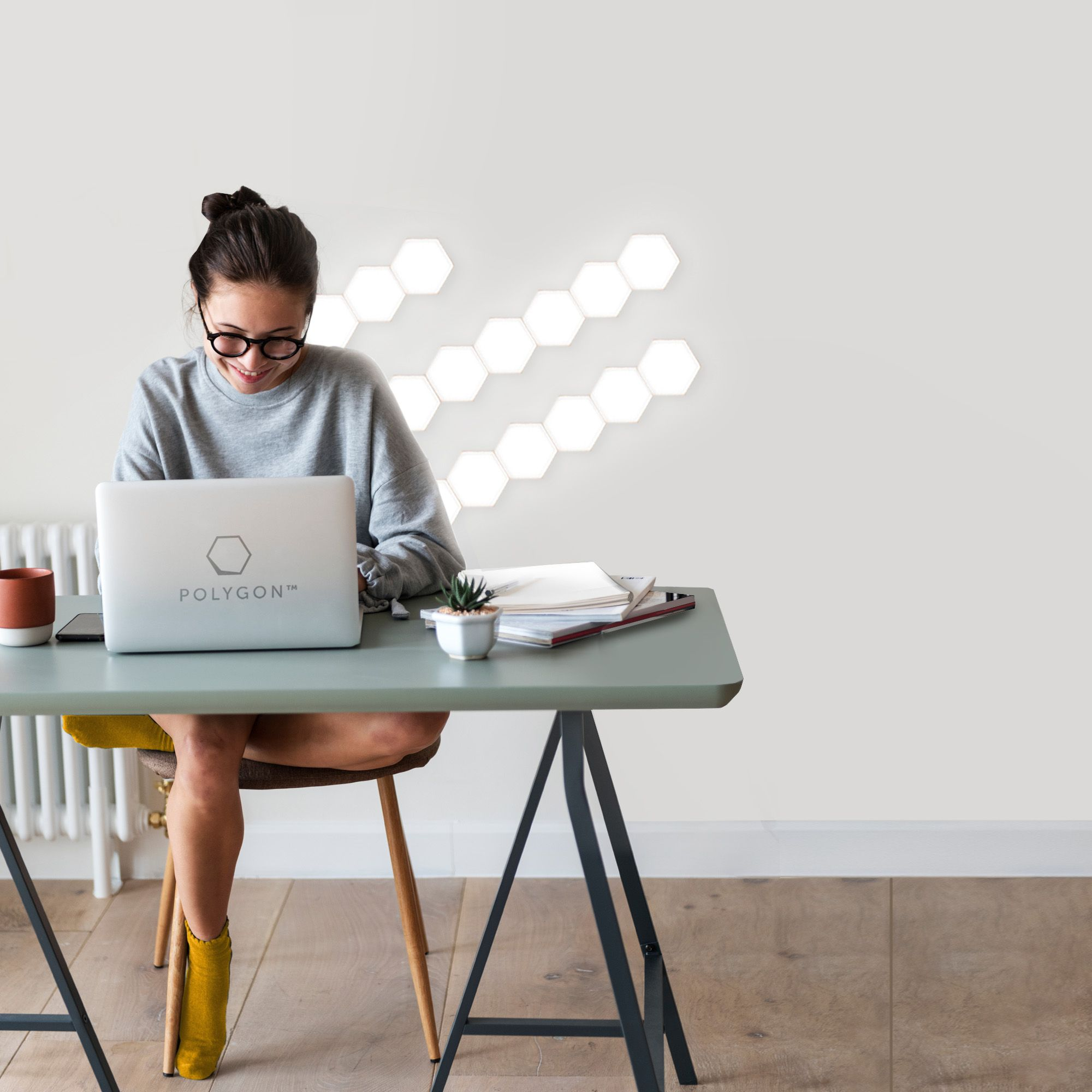 Woman Working At Desk On Laptop With Polygon Lights In The Background Lights Magnetic Tiles Polygon