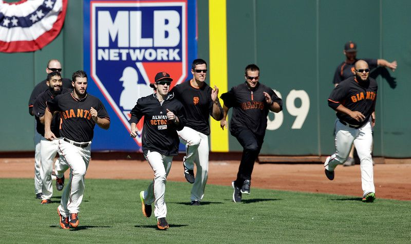 Members of the San Francisco Giants run during batting practice before Game 3 of baseball's NL Division Series against the Washington Nationals in San Francisco, Monday, Oct. 6, 2014. (AP Photo/Jeff Chiu)