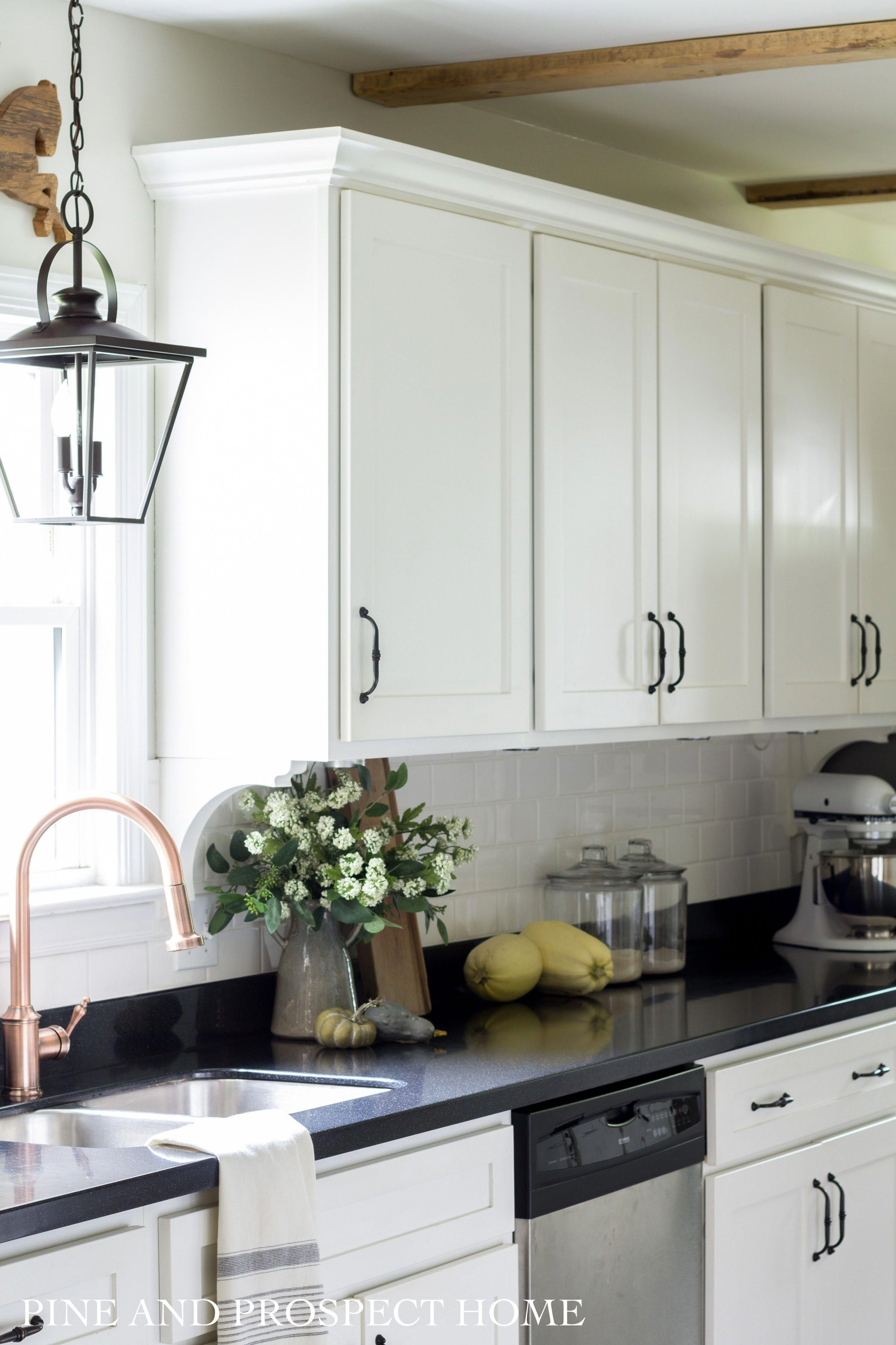 Rustic modern galley style kitchen with white and