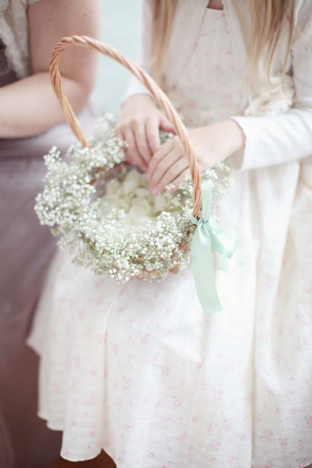 Simple flower girl basket decorated with baby's breath