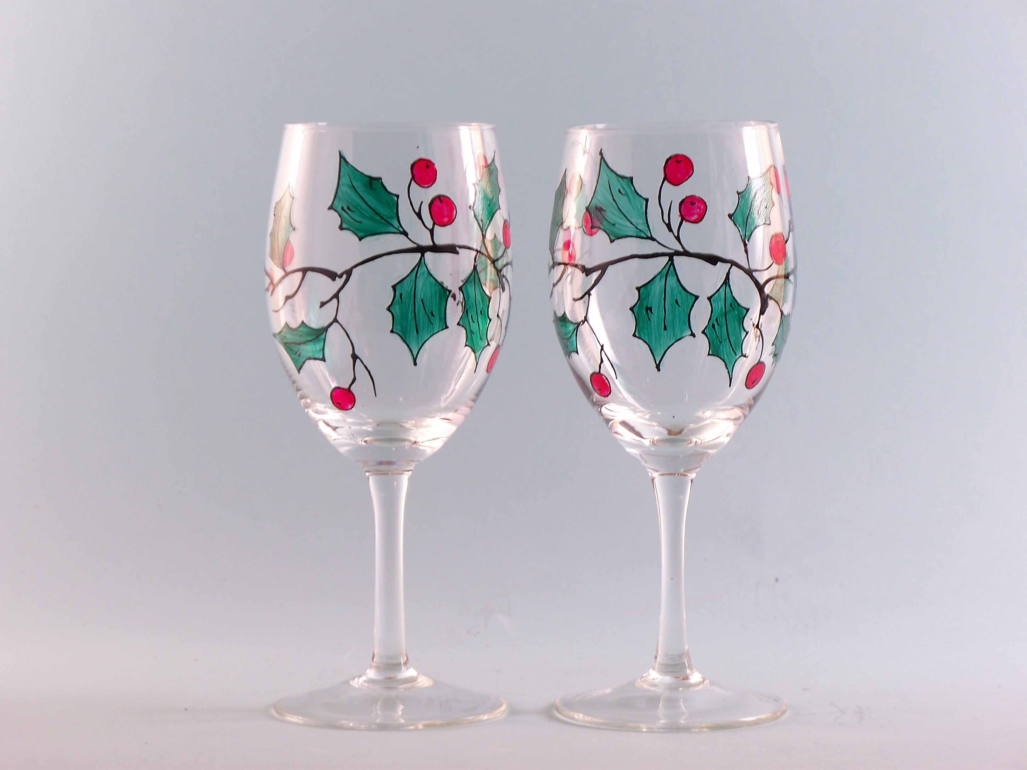 Hand painted holly wine glasses set of two christmas for Hand painted wine glass christmas designs