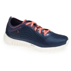 A flexible running shoe shaped with breathable mesh features NanoWeb support for sleek, lightweight style. Inspired by high-performance Z-rated tires, the sole is designed for optimal control, traction and speed. Color (s) : black/ neon pink/ white, blue peak/ chalk/ punch pink, grey/ pink/ silver. Brand: Reebok. Style Name: Reebok 'Z Goddess' Running Shoe (Women) . Style Number: 994631.