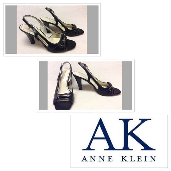 "Black leather Anne Klein pumps size 10B Black leather pumps with white stitching. brown iridescent bar shaped bead with silver hardware detail to toe. These are very classy. Original price sticker on the sole still. Have been worn once and show only minimal wear to sole. Photos are accurate.  3.75"" heel Anne Klein Shoes Heels"