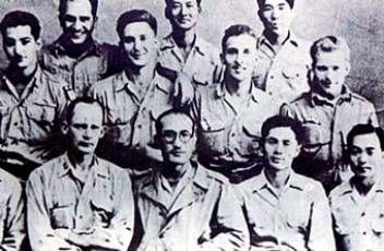 Kim Gu's Korean Independence Army 2nd Brigade officers with US OSS instructors in 1945.