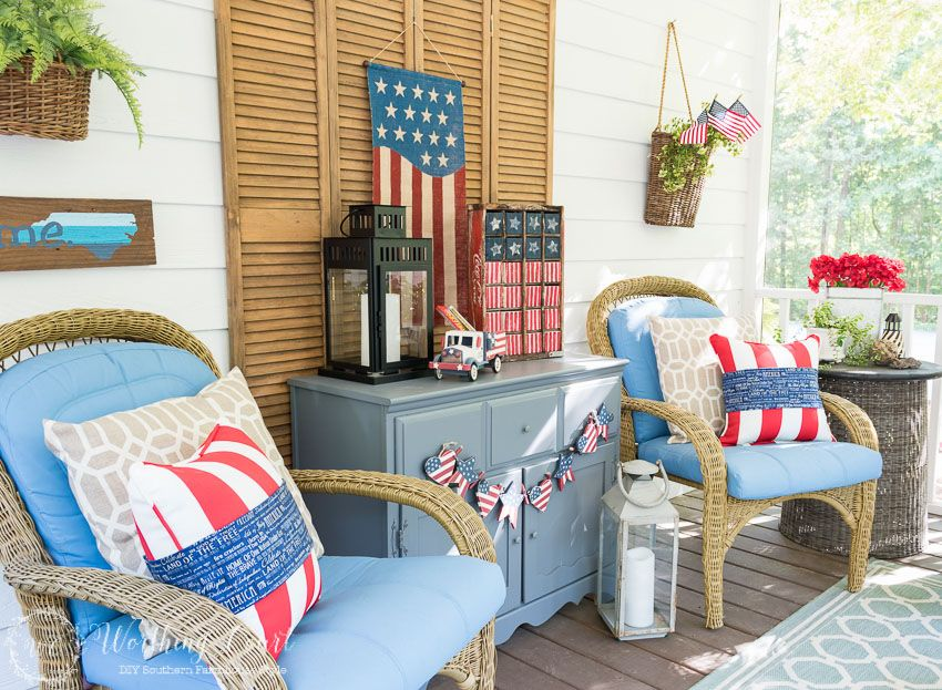 A Farmhouse Porch Filled With Loads Of Red White And Blue Vintage Americana Patriotic Decorating