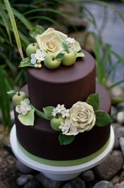 chocolate cake with orange and red yellow n forest green roses and instead of apples they will be pumpkins. Perfect!!