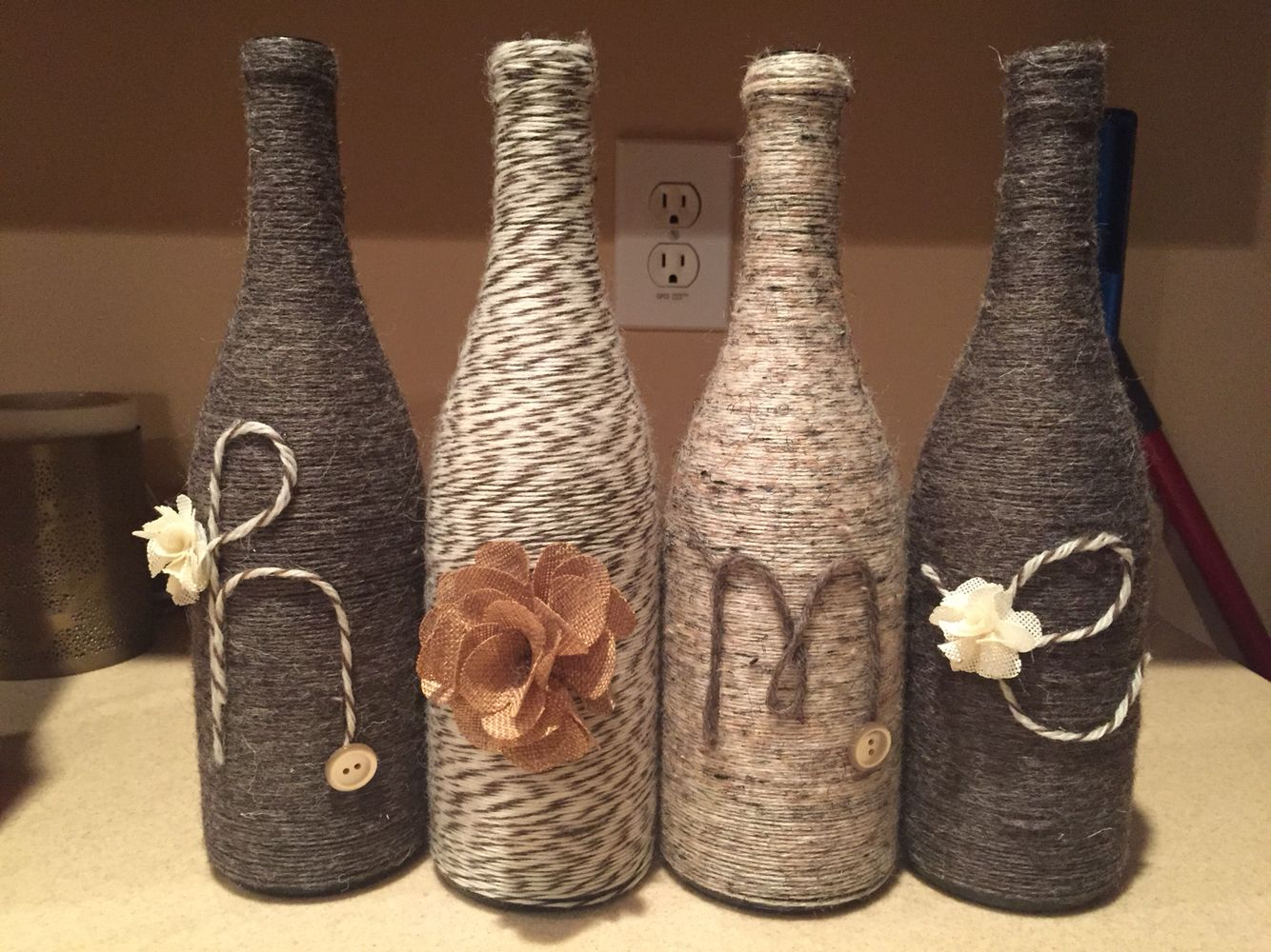 Wine bottles decorated with yarn craft time pinterest for How to make wine bottle crafts