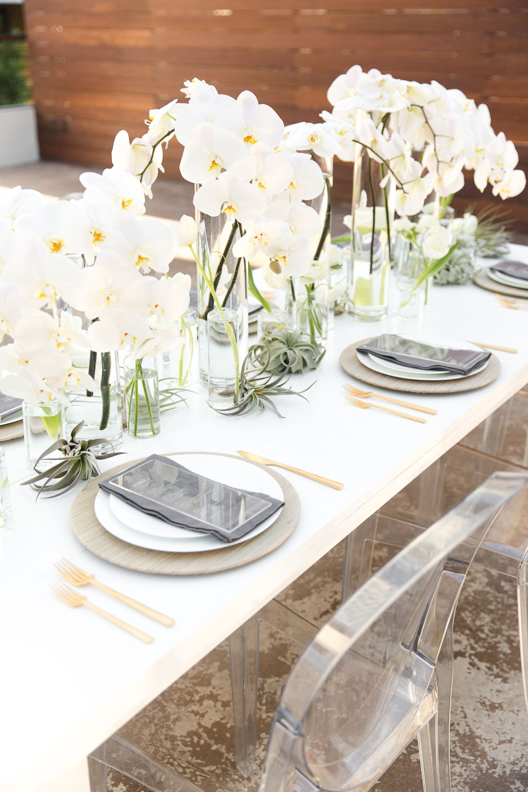 Modern wedding table setting with cascading orchids #centerpiece ...