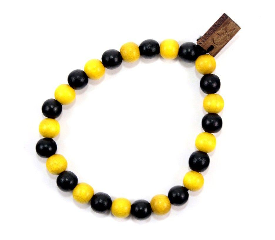 Two Tone Bracelet in Black & Yellow $10.00 #woodenbracelet #woodbracelet #goodwoodnyc #Woodjewelry #beadedbracelet