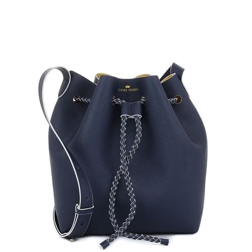 9ae706271795 The Reserve Navy Crossbody - Unleash your inner fashionista with the  on-trend bucket bag. Navy saffiano leather is contrasted with a white edge  paint that ...