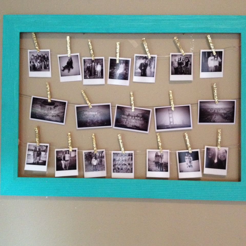 Polaroid Pictures Hung By Clothespins On Wire In A Large Empty Wiring Board Bee Frames Picture Frame