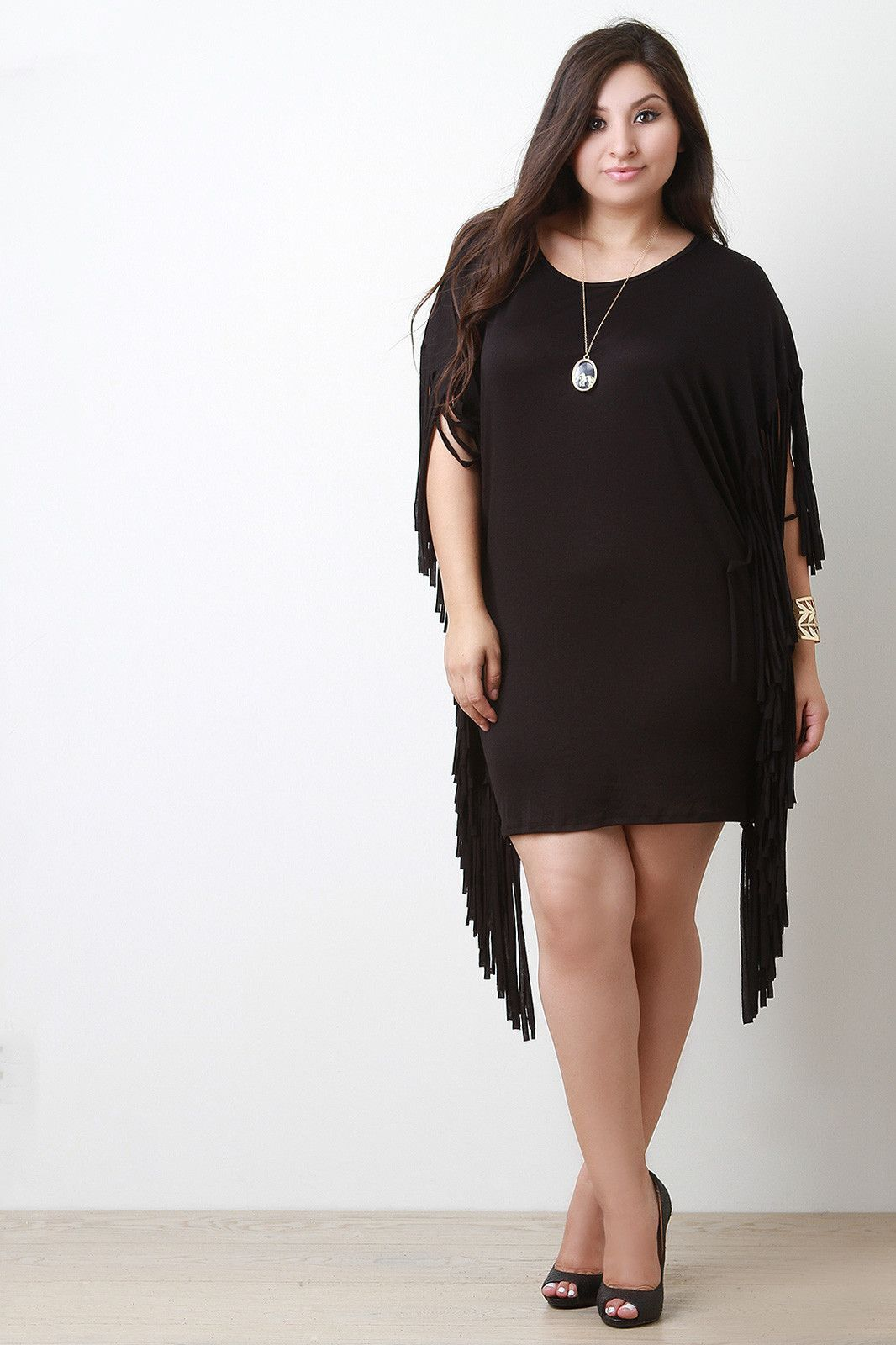 65ac54d0766 Description This plus size jersey knit dress features a round neckline