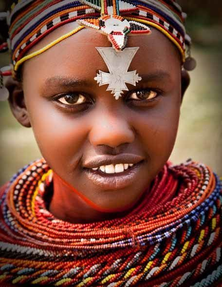 Young Maasai girl in costume