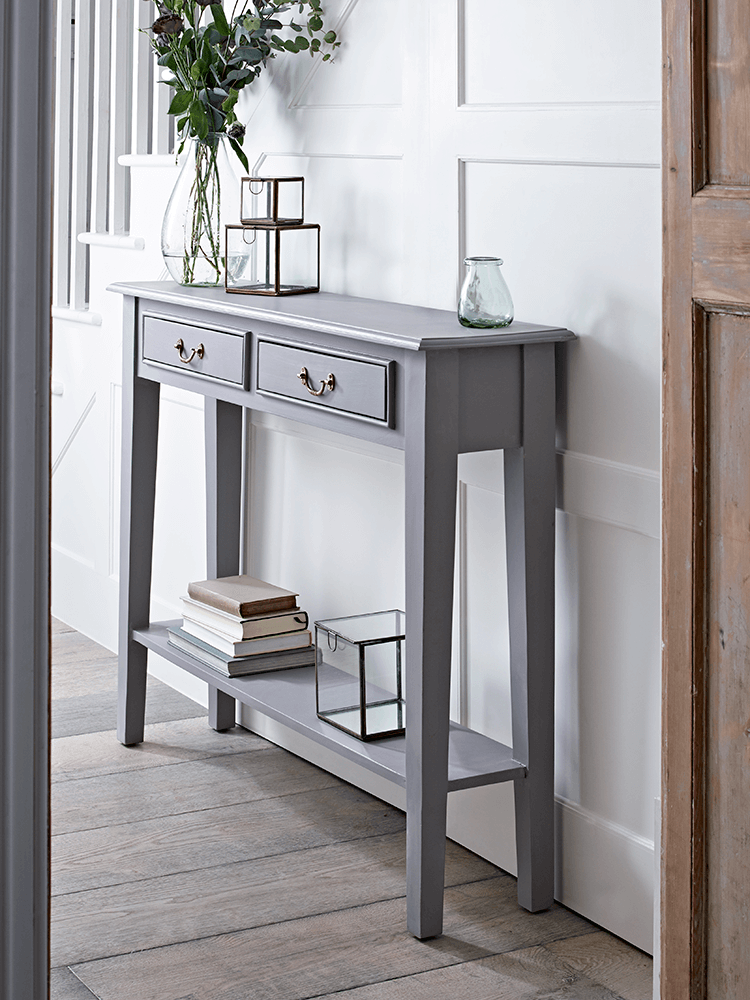 With A Warm Grey Painted Finish And Two Slender Drawers With