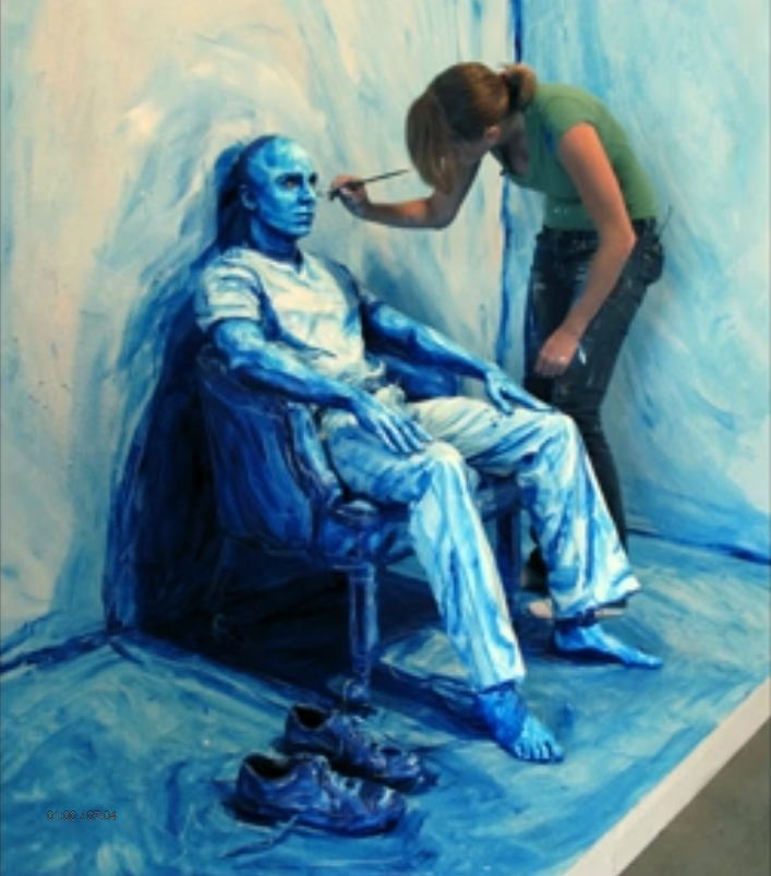artist painting directly onto subject