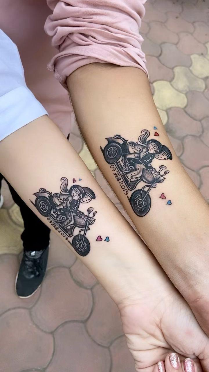 Photo of Pareja de tatuajes