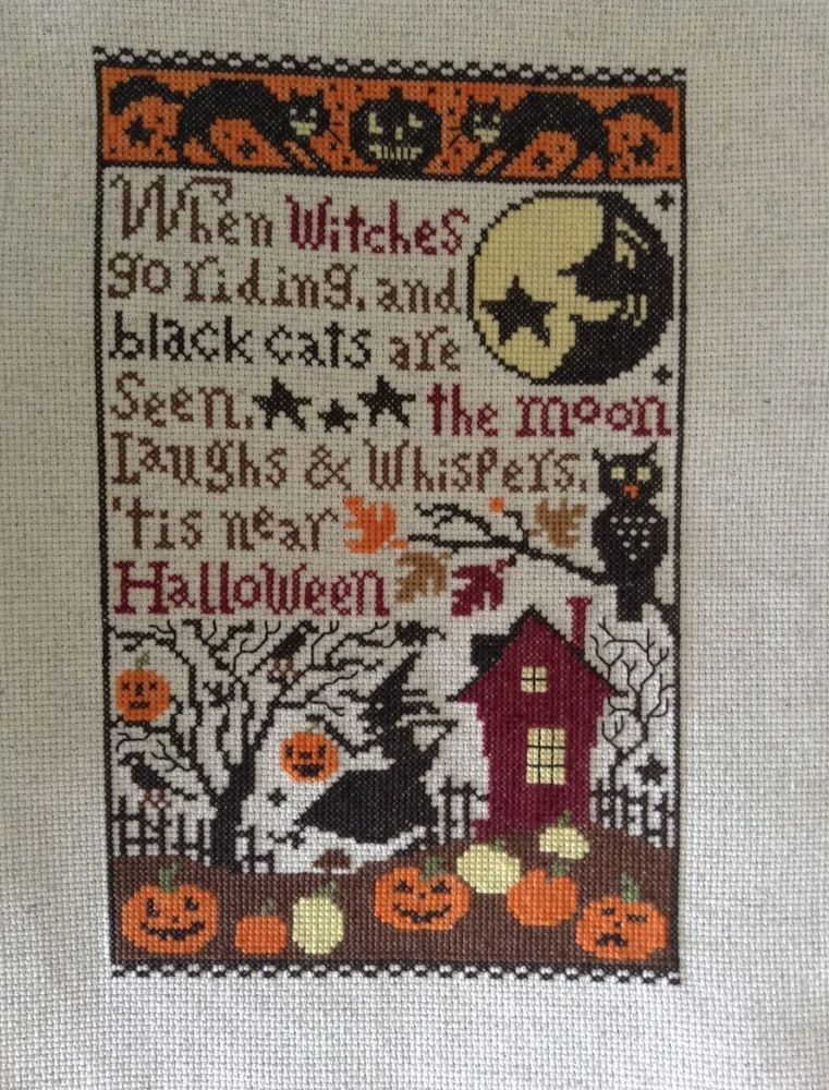 completed cross stitch Prairie Schooler Halloween sampler When Witches go riding