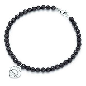 9e7e34162 Tiffany & Co. | Item | Return to Tiffany™ mini heart tag in silver on a  black onyx bead bracelet. | United States