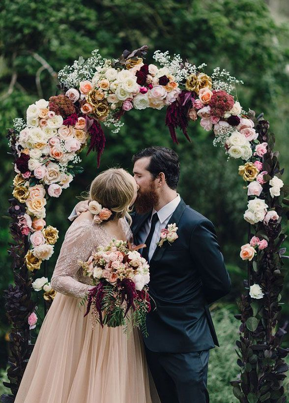 "Glamour and drama? Check and check! The deep colors and metallic accents of this floral arbor have us saying ""I Do!"" #CeremonyArbor"