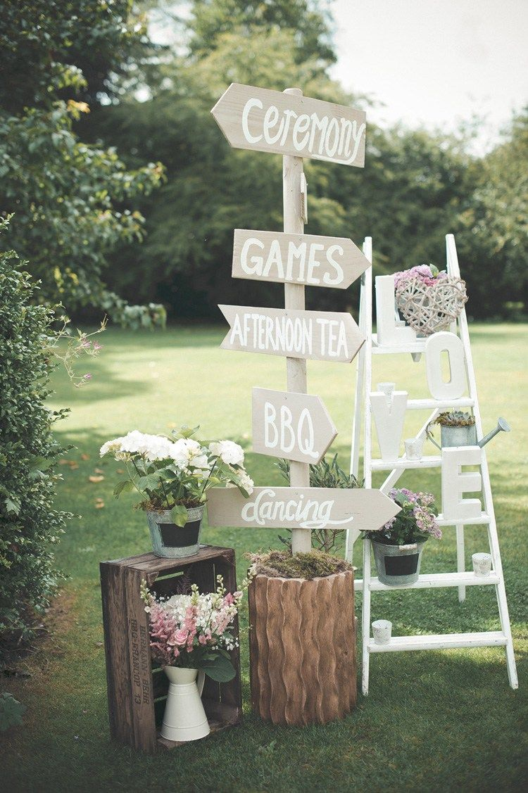 wooden sign post beautiful summer garden party wedding