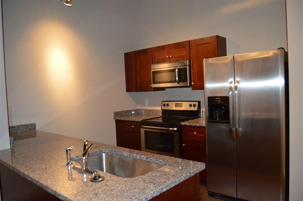 Annex Lofts Memphis Tn Second Floor Flat Kitchen Kitchen Kitchen Cabinets Flooring