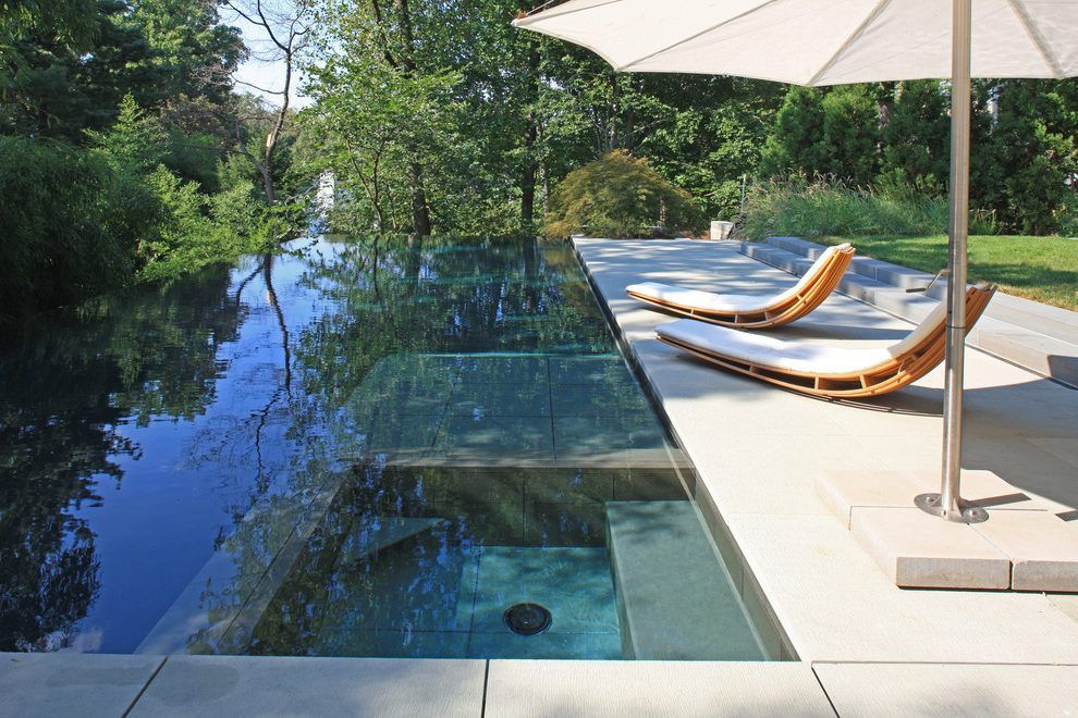 Disappearing pool pool modern with hardscape designer infinity pool ...