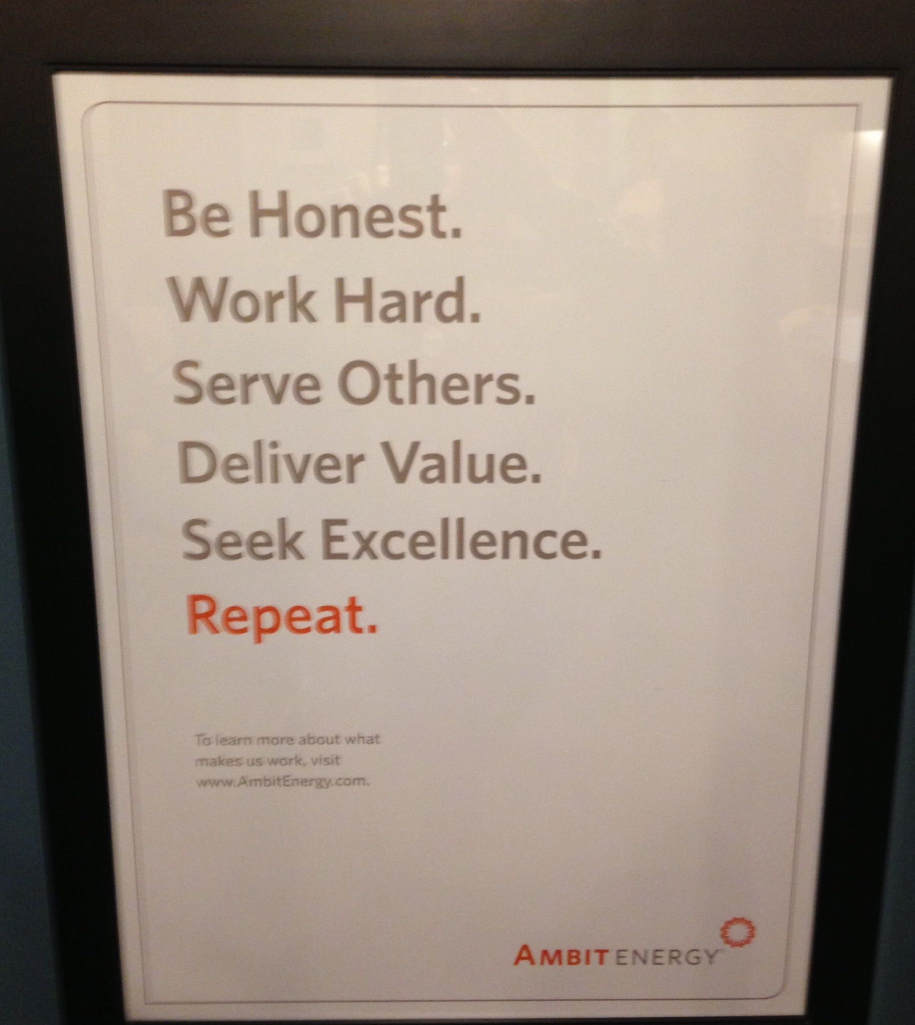 A poster on the wall in Ambit Energy Headquarters in