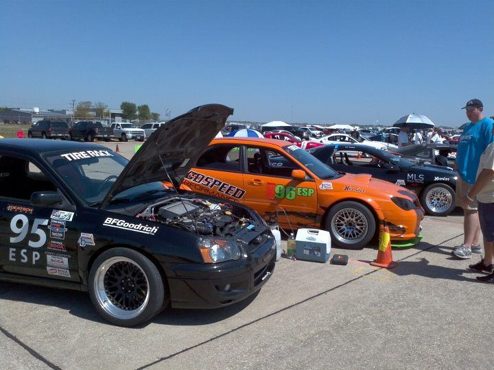 """Back half of the ESP grid at the 2012 SCCA Solo Nationals. This was before the Eagle Talon caught fire and had to be """"quarantined"""" away from the rest of us. 95 ESP is the car I was driving; it's a 2004 Subaru Impreza WRX owned by Drew Little. 96 ESP is Brad Owen's 2006 WRX. 97 ESP is Eric Thompson's LS1 powered Camaro Z28, codriven by Bob Anderson."""