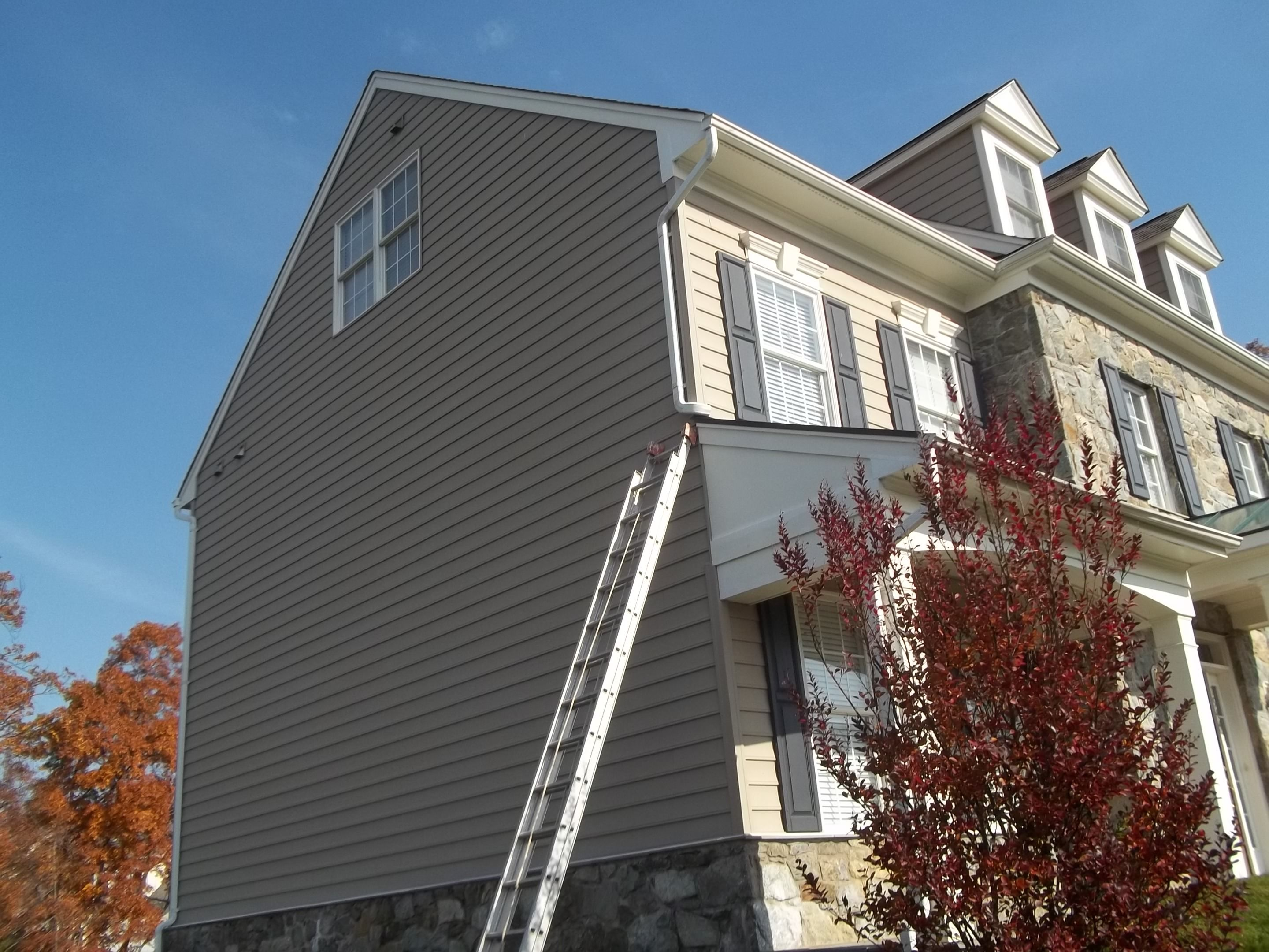 Exterior Paint Application of left facade This required the use