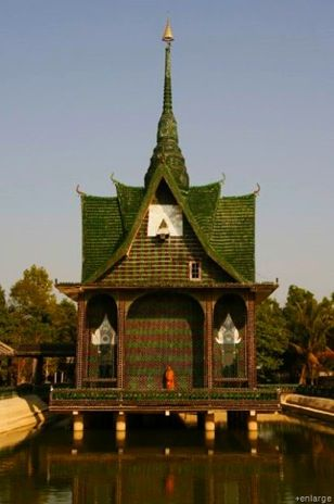 """Buddhist monks built the """"Wat Pa Maha Chedi Kaew"""" temple in the Sisaket province of Thailand from one million Heineken and Chang beer bottles."""