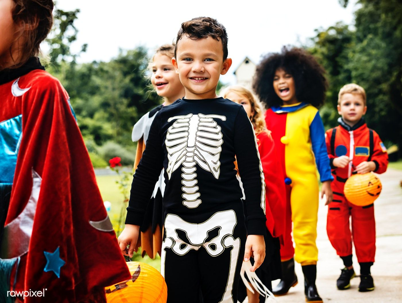 Download premium photo of Young kids trick or treating