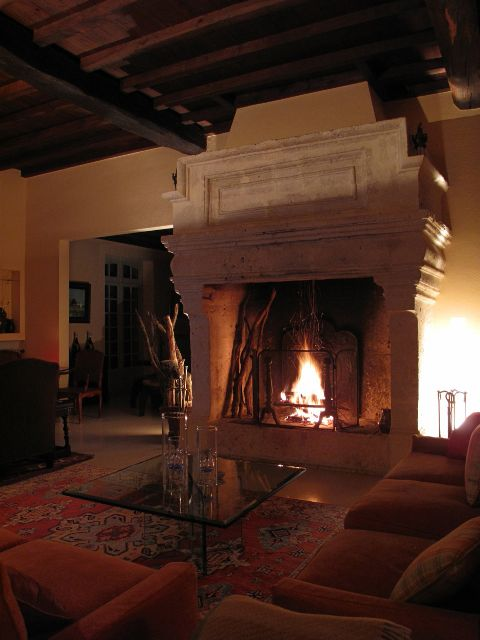 Fireside nights in front of a massive antique french for Isokern outdoor fireplace prices