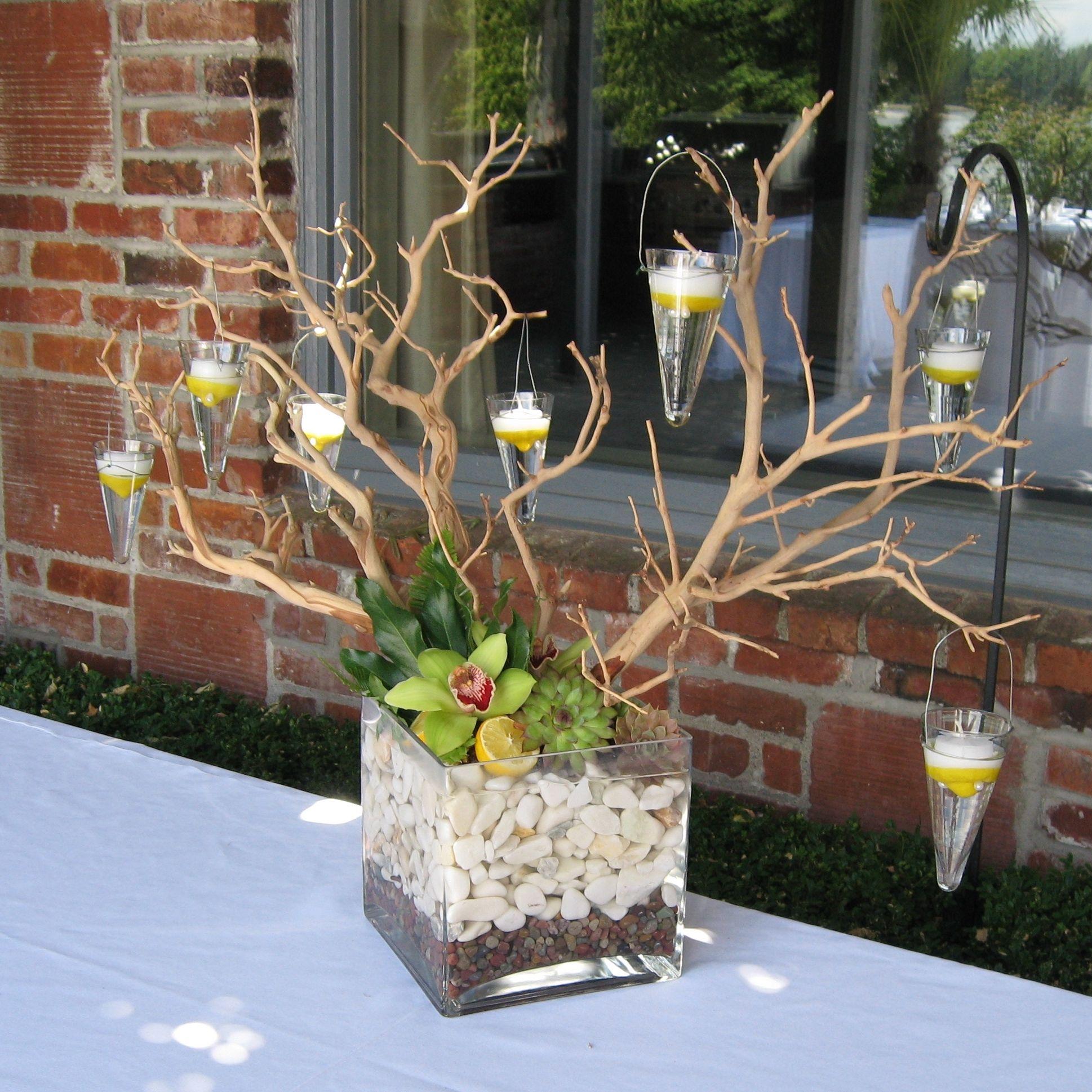 Buffet floral arrangement with a manzanita branch with for Floral arrangements with branches