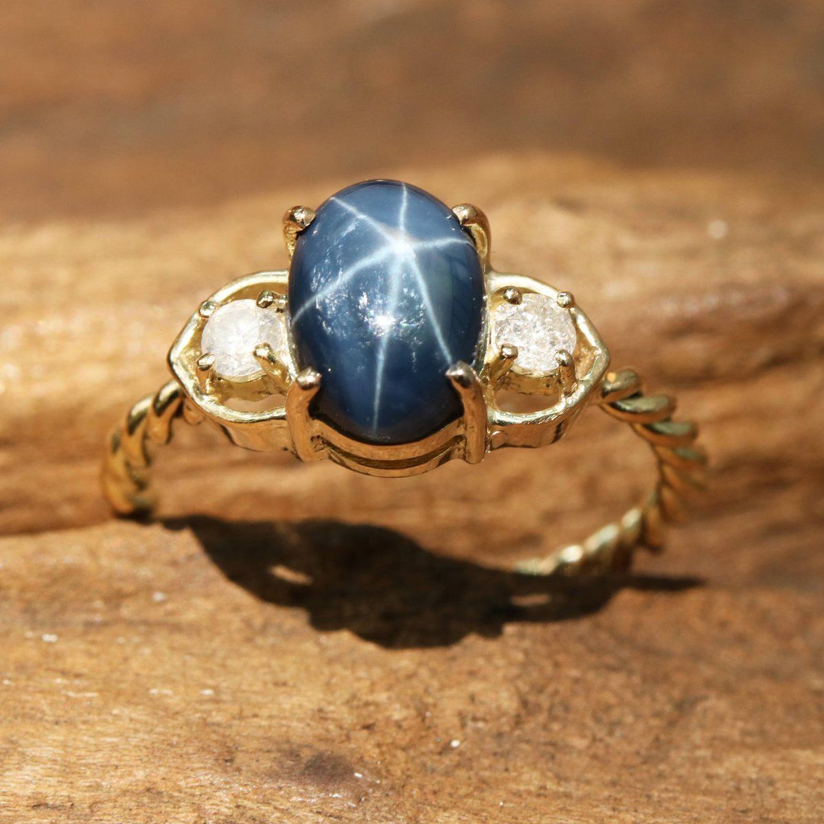 Oval Blue Star Sapphire Ring With Tiny Diamond Side Set In Prongs Setting On 10k Gold Twist Design Band