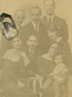 Family photograph showing the Frank family in 1923.  Back row: Otto and Robert Frank, Erich Elias, Sitting Hortense and Herbert Frank, Lotti Frank and Leni Elias with Stephan on her knee. A photo of Edith Frank has been added.