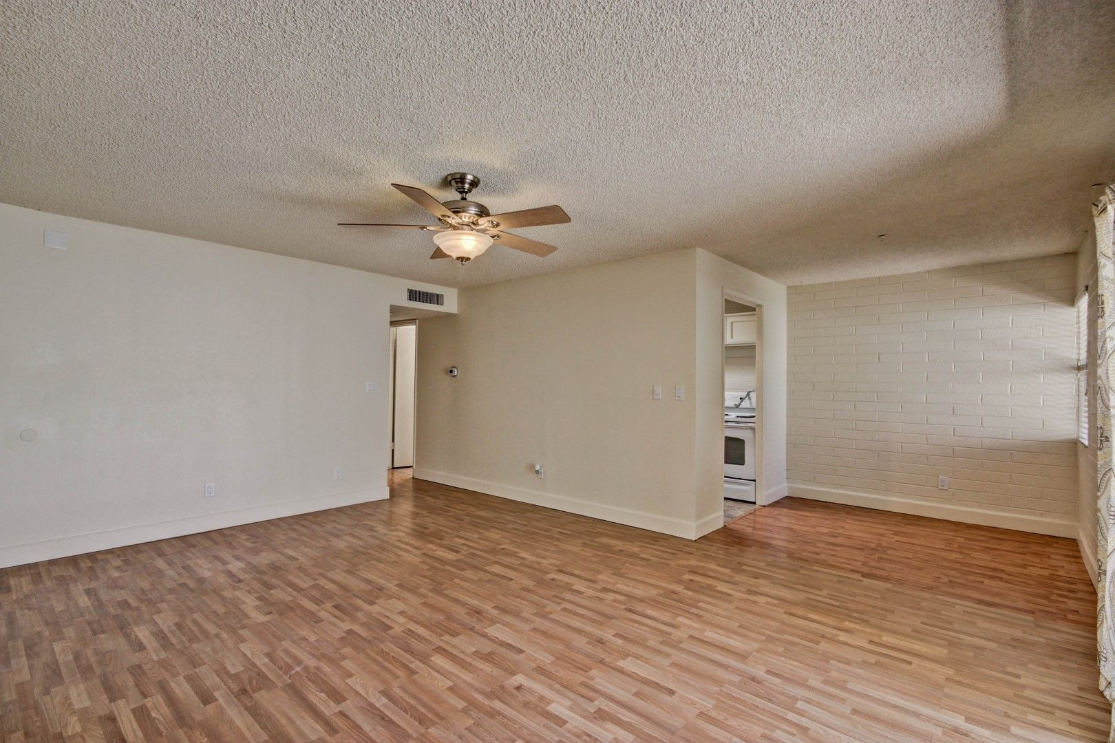 Light, bright and open living room with dining area directly off of kitchen