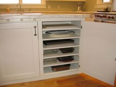 Kitchen Storage Ideas: Add additional shelves in lower cabinets to store flat items.