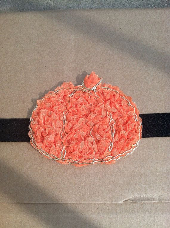 3 inch orange chiffon pumpkin. The pumpkin can be affixed to either 5/8 inch white fold over elastic or 5/8 inch black fold over elastic.