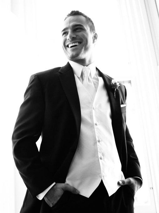 Hmmm black tux with white vest and tie (no purple) or some purple ...