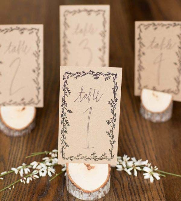 winter wedding stationary inspiration elegant garland wedding ideas table numbers bohemian