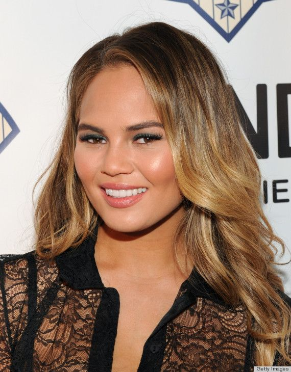 Chrissy Teigen's ombré shoulder-length hairstyle, green eyeshadow and nude lipstick accentuate her luminous complexion.