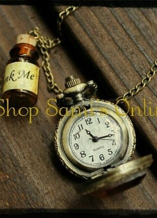 Alice in Wonderland small pocket watch with drink me vial