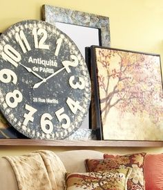 Pier One Imports Wall Decor | Pair Bold Clocks With Bold Art For Added Drama